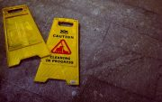 caution sign on floor - slipping, tripping accident